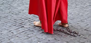 Penitent walking barefoot with heavy chains, Holy Week Procession, Santa Cruz de la Palma
