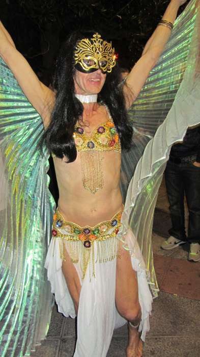 Man dressed as a belly dancer with wings