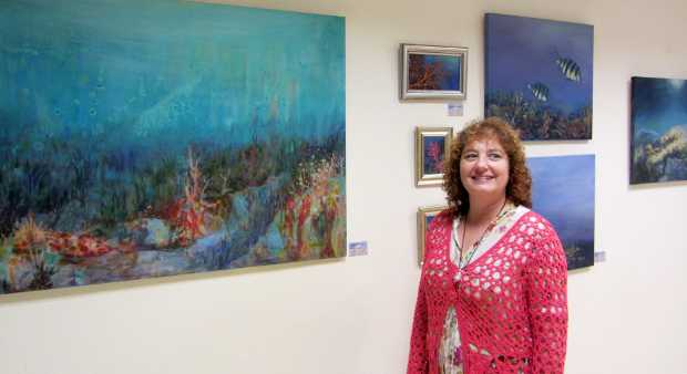 Alba Molina with some of her paintings, Santa Cruz de la Palma